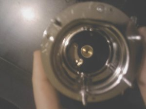 "6. Looking straight in to the reel from the drive side, with the drive side plate removed. Shows the brass ""bullet"" in to which the spindle goes, and the components of the ratchet."